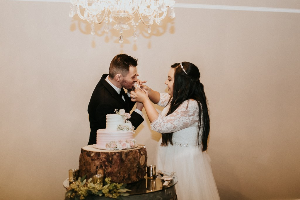 Megan Claire Photography   Arizona Wedding Photographer. Beautiful church wedding. Bride  and Groom wedding reception at elegant barn in Gilbert, Arizona bride and groom cutting cake photos