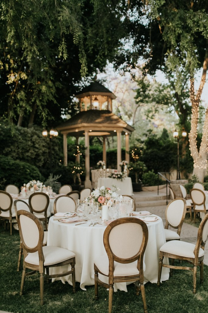 Megan Claire Photography | Arizona Wedding Photographer. Beautiful summer wedding in the desert at the Wright House in Mesa, Arizona. Pink and white center pieces. Beautiful reception decor