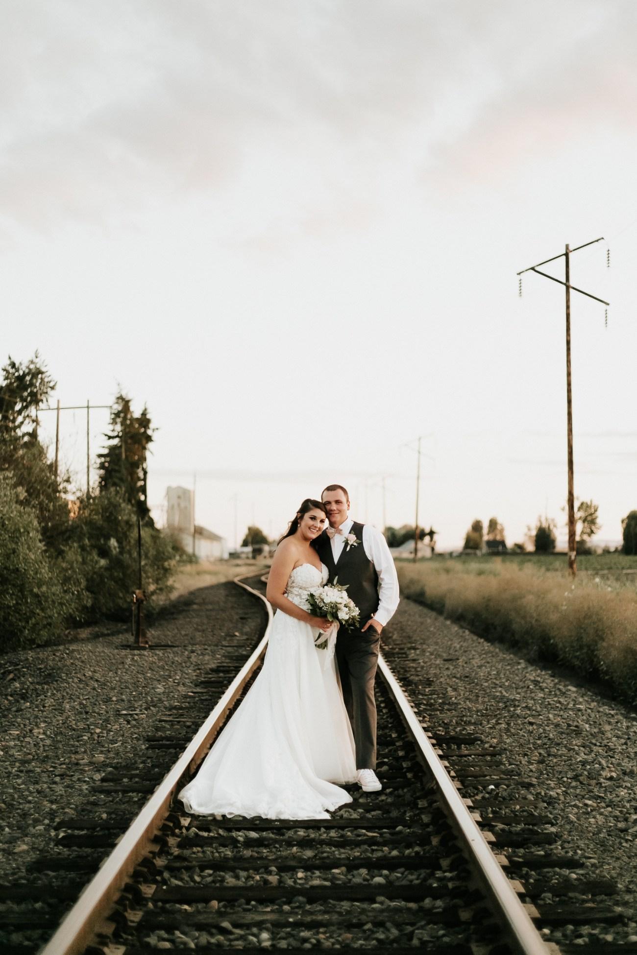 Megan Claire Photography | Arizona Wedding Photographer | Megan-Claire.com | Beautiful summer wedding in Portland, Oregon. Summer forest wedding inspiration. Bride and groom portraits on train tracks