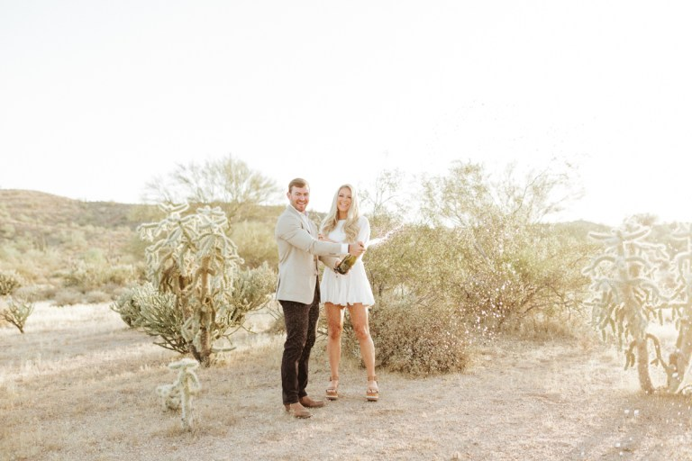 Megan Claire Photography | Arizona Desert Engagement Photos. Popping champagne @meganclairephoto Megan-claire.com