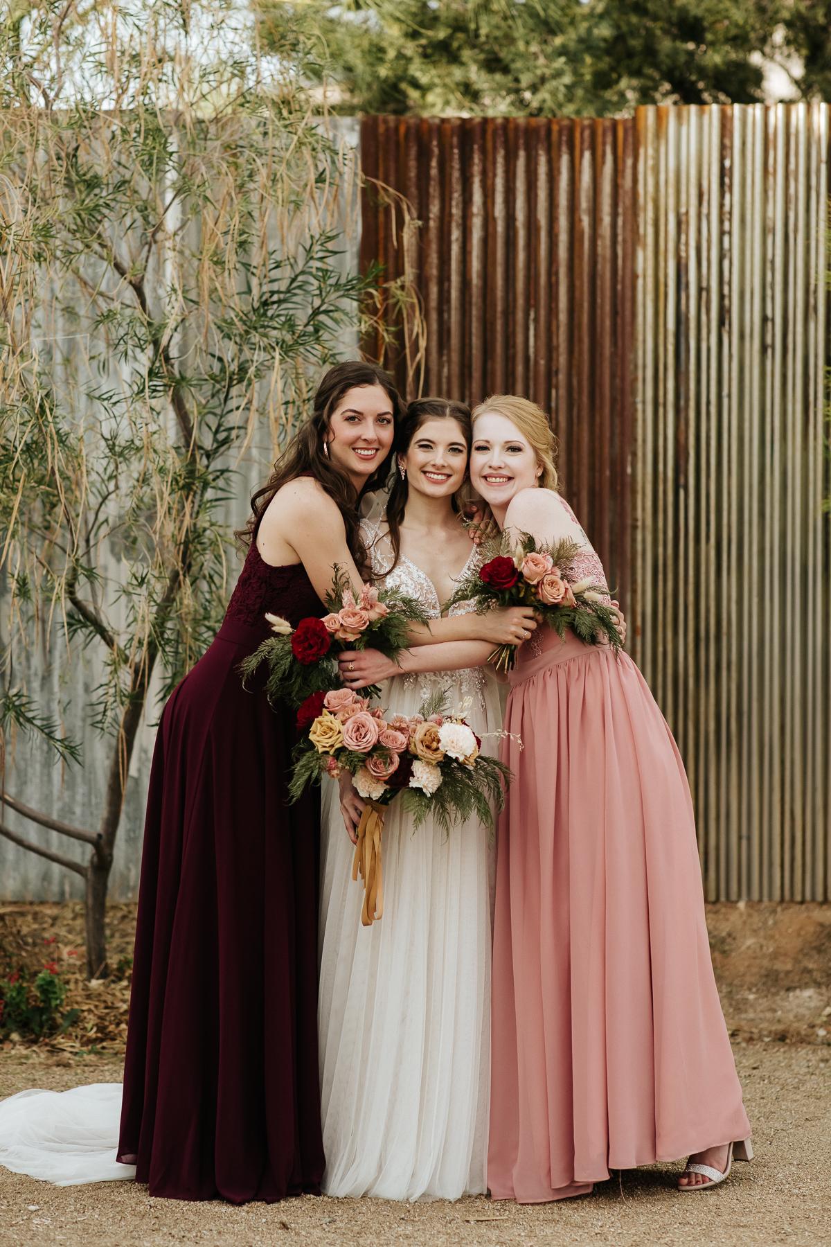 Megan Claire Photography | Arizona Wedding Photographer.  Rustic Glam Backyard Wedding. Maroon and Pink Bridal Party Photos