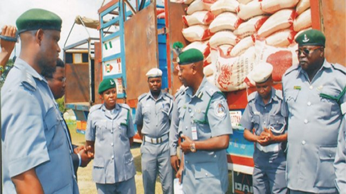 Nigeria Customs intercepts bags of expired smuggled rice, Indian hemp in Lagos