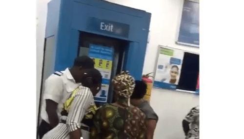 Woman Cries, Blocks Bank's Door After Fraudsters Wiped Her Account (Photos)
