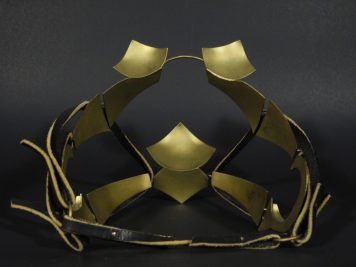 "Blinders, brass and leather. 7""x 6""x 7"""