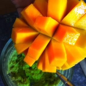 mango cut into a grid pattern