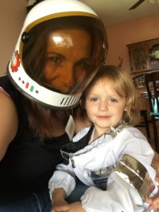 Megan Kerry, pictured with her daughter in an astronaut costume