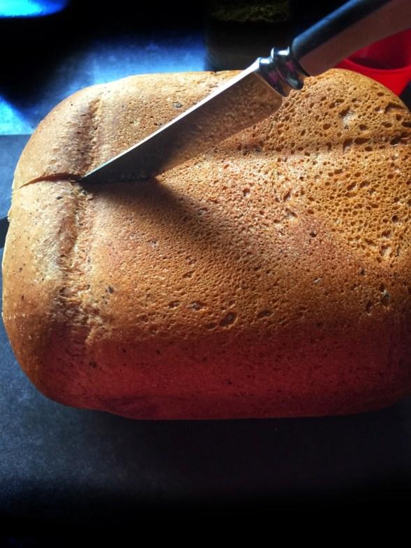 Easy Vegan Bread being sliced lengthwise