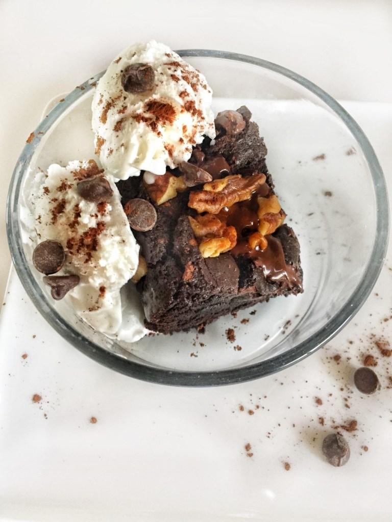 Ultimate Vegan Brownies shown served with vegan ice cream