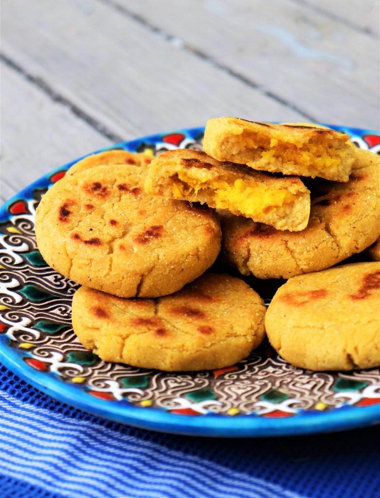 Kabocha Squash and cheese vegan pupusas shown on a blue plate
