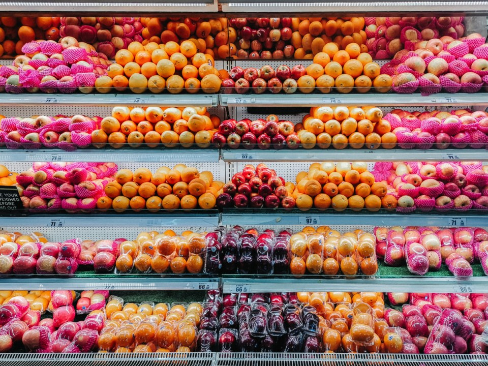 rows of fruit at the grocery store