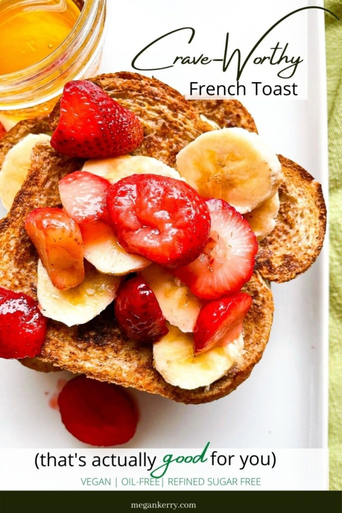 Vegan French Toast topped with fresh strawberries, sliced banana and maple syrup.