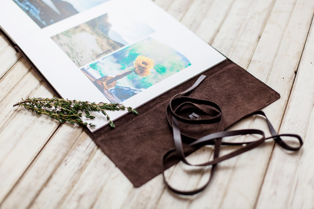 Open view of Leather bound wedding album by laramie wyoming wedding photographer