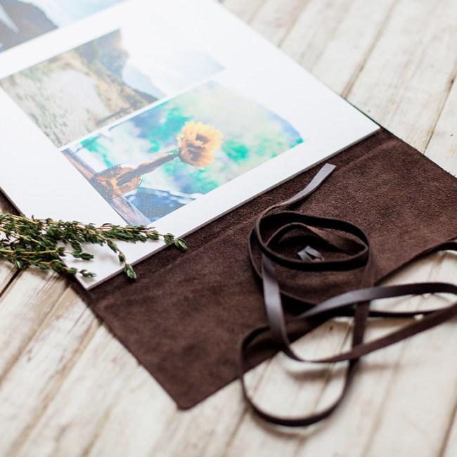 Open view of Leather bound wedding album by laramie wyoming wedding photographer