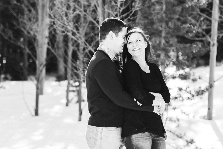Black and white image of a recently engaged couple near medicine bow national forest