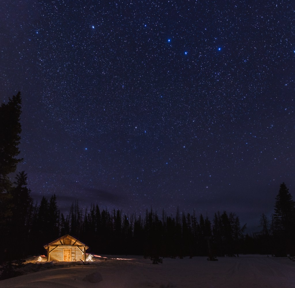 stars over snow survey cabin, in snowy range mountains, Medicine Bow National Forest, Wyoming.