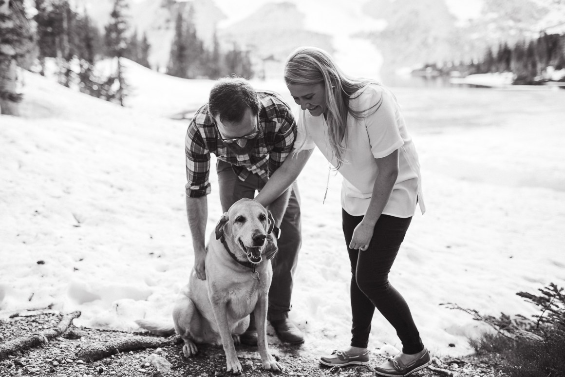 Engagement photography in the mountains of Wyoming by Laramie based photographer. Couple with dog