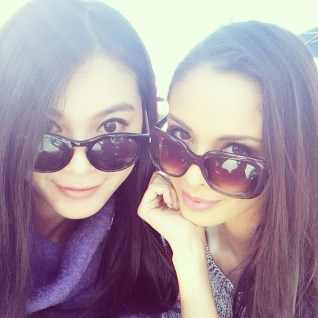 @meganbata: Switching sunglasses with @wenxiay ❤️ hello from Miss World 2012 & 2013!