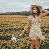 girl in a field of tulips