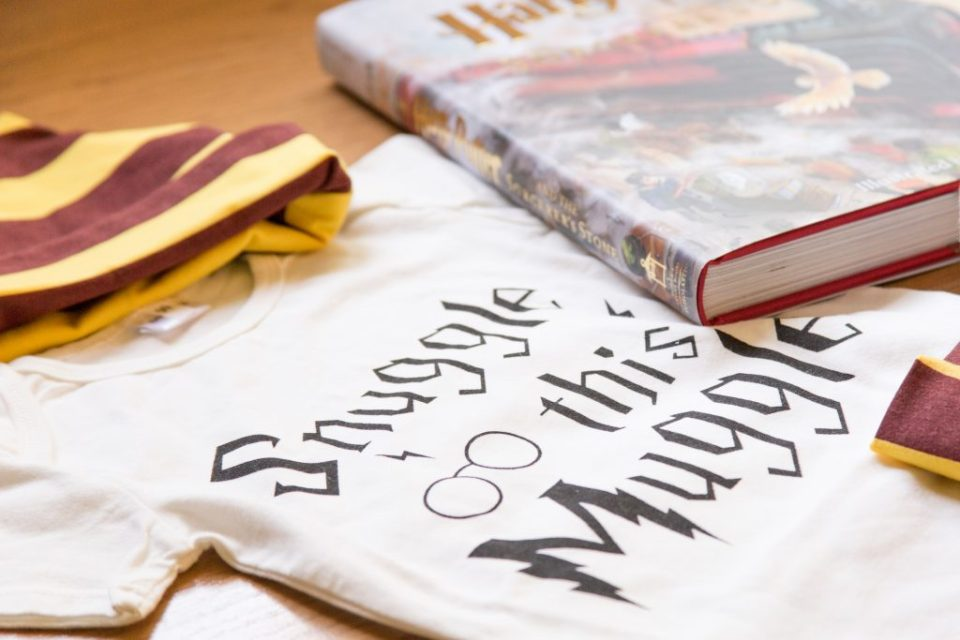 Close up of a white baby shirt with the words snuggle this muggle