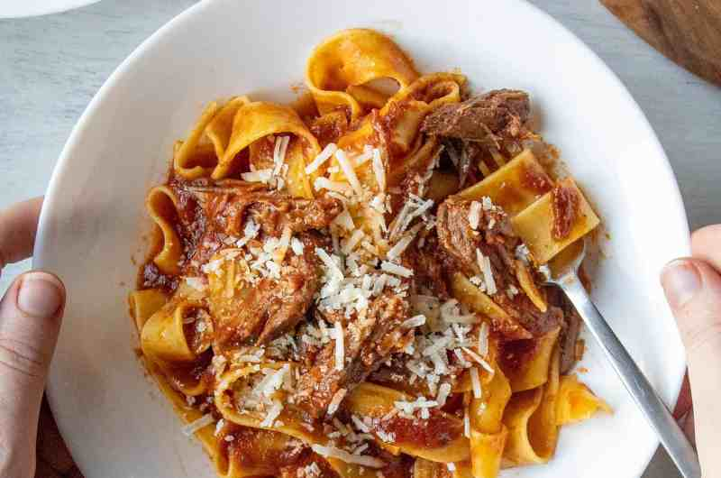 Slow Cooker Beef Ragu in a white bowl with a fork