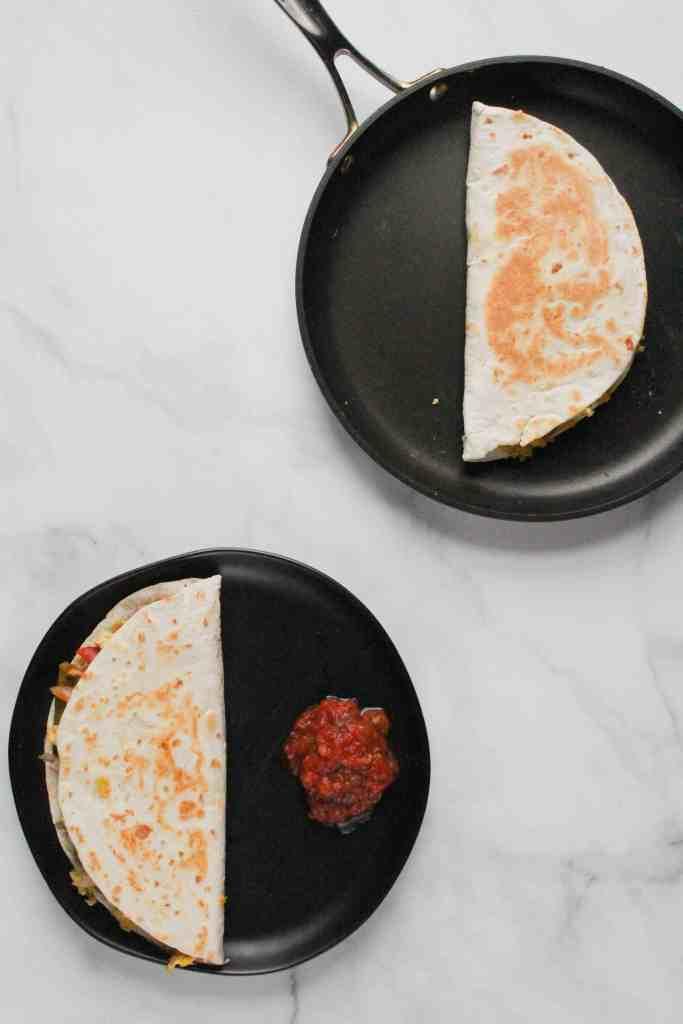 Breakfast Quesadillas on a black plate.