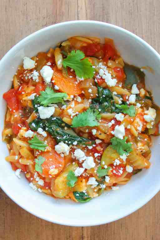 bowl of Farmers market orzo topped wiht feta