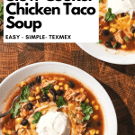 Slow Cooker Chicken Taco Soup topped with cheese and sourcream. on a wooden background.