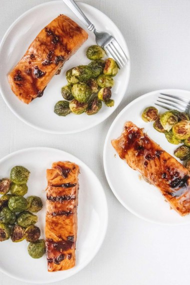 Honey Garlic Glazed Salmon with Roasted Brussel Sprouts on a white plate