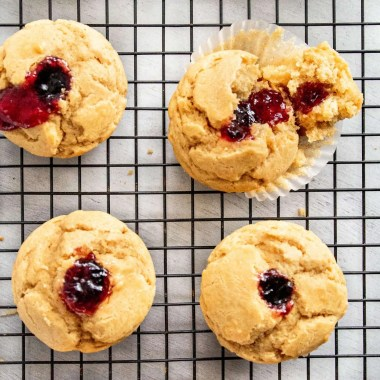 Peanut butter and Jelly Muffins on a black cooling rack