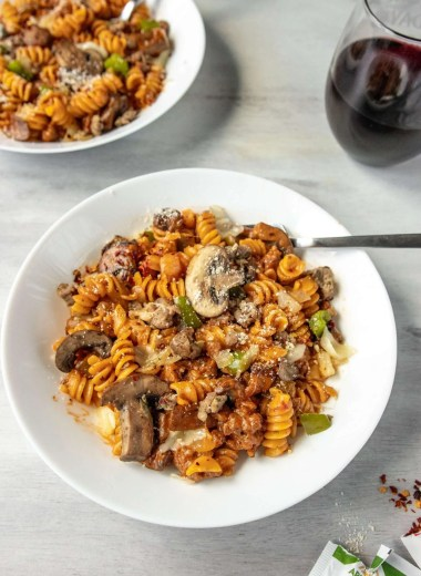 Pasta with a red sauce and mushrooms, onions and green peppers.