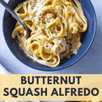Butternut Squash Alfredo in a blue bowl with extra parmesan cheese on top.