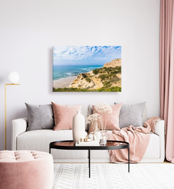 A canvas print hung over a couch in a living room.