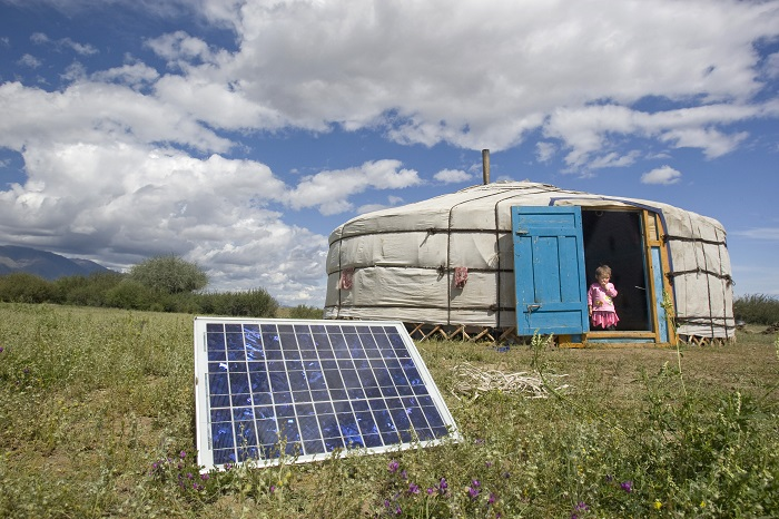A family using solar energy in generating power in Tarialan soum, Uvs Aimag (Uvs Province).  In remote soums many people live without electricity due to remoteness, vast distances and scattered nomadic way of life.   These photographs depict the families working in the sea buckthorn field and shows their living conditions in a ger (Mongolian traditional tent).