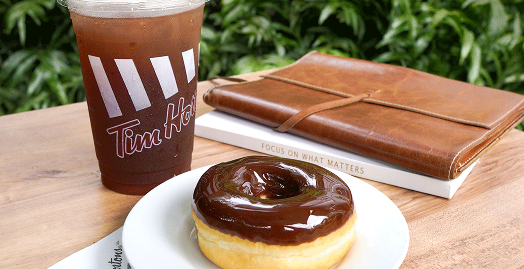 A chocolate donut and coffee from Tim Hortons