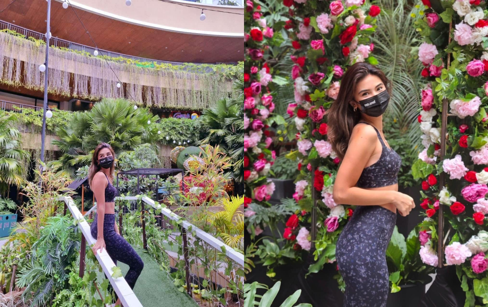 Lexi Mendiola stops and smells the roses at Southwoods Mall.