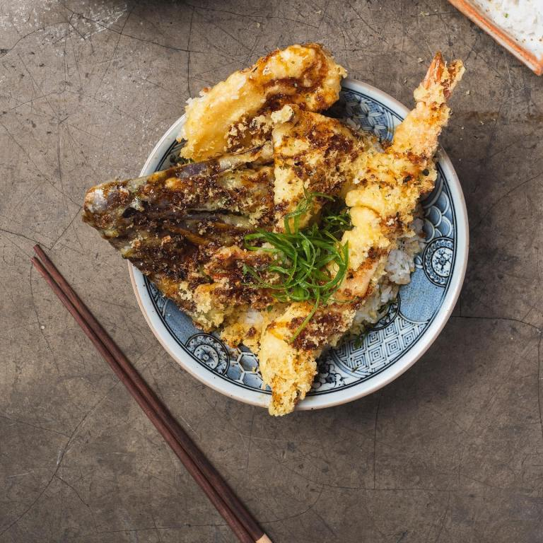 If you want rice with your tempura, then add Tempuradon to your cart. This meal is made from crunchy golden brown vegetables, fish, and shrimp tempuras over warm rice. The bowl is then topped with a light soy dressing!