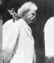 Mark Twain with a kitten, who must not be Bambino