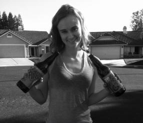 Me posing with some beers a friend gave to my family. I chose this picture because it always makes me feel slightly uncomfortable. I was still recovering from my hospital stay and was 105.