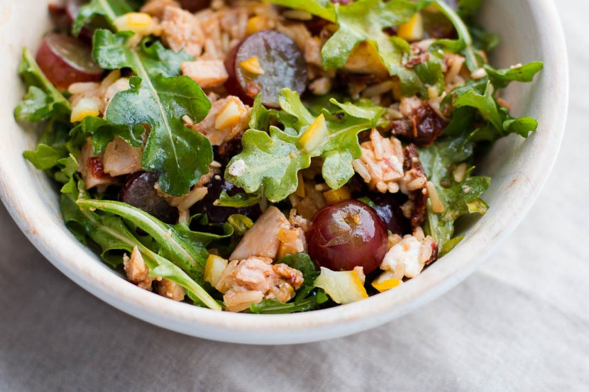 <yoastmark class='yoast-text-mark'>This Leftover Chicken Bowl Recipe is an easy and quick way to get rid of leftovers.</yoastmark> Brown rice, sun dried tomatoes, preserved lemon, feta, grapes, and arugula combine for a light, healthy, and filling bowl. | www.megiswell.com
