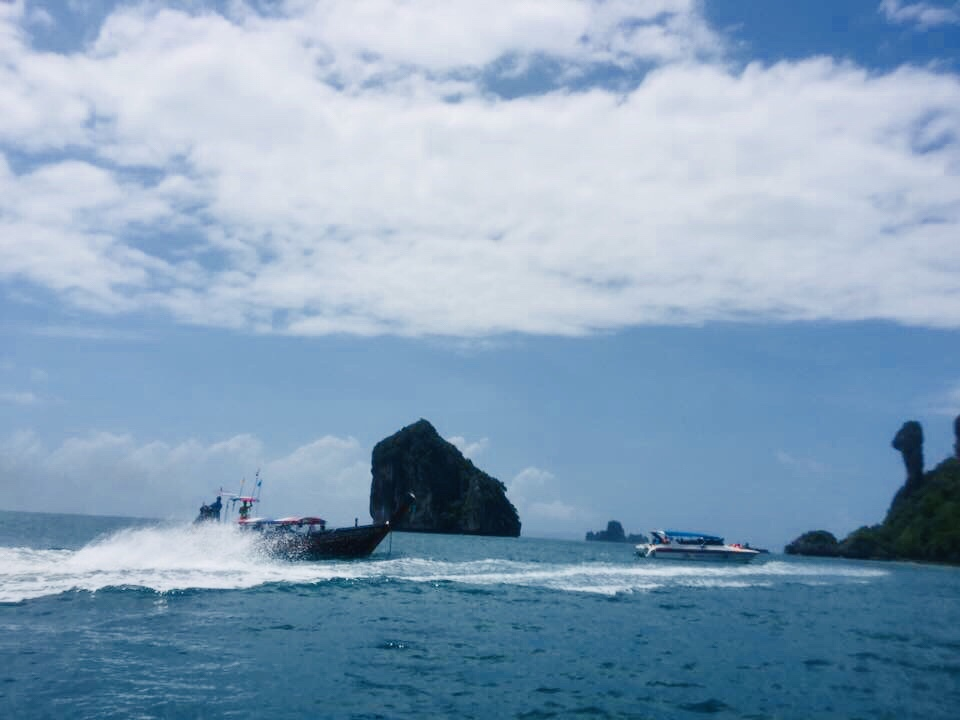 Speed Boat approaching island.