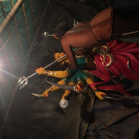 The artisan painting the eye of Maa Durga