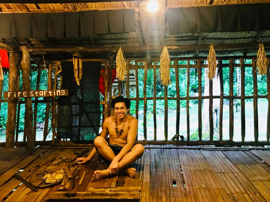 The happy tribesman who creates fire in the traditional way.