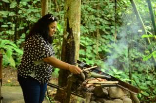 Me cooking traditional food at the Mari Mari village.