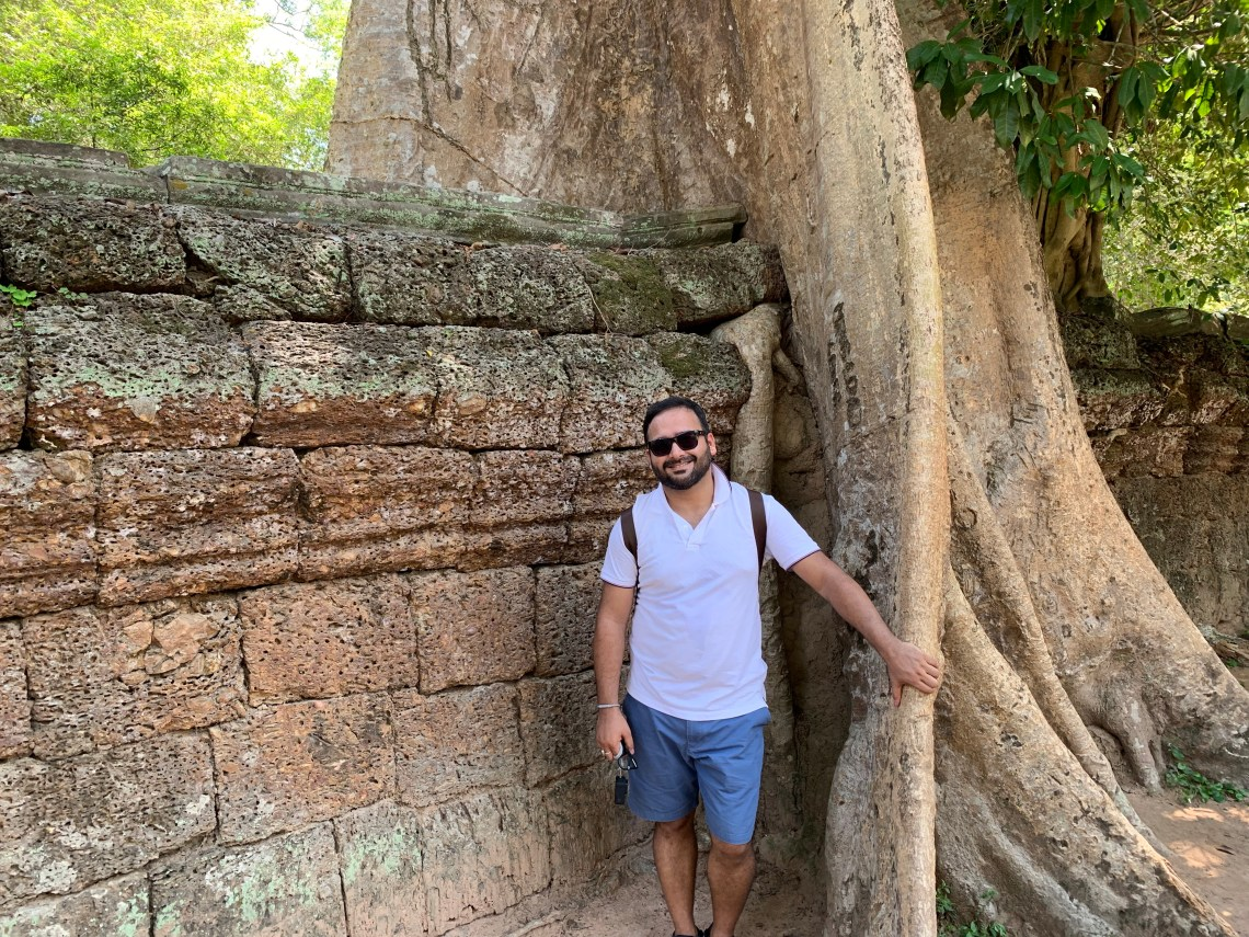 The amazing union of the tree and wall of the temple at Ta prohm,