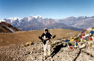 Atop Thorong La, 17,769 ft.. at sunrise, the Annapurna trek. this is the highest mountain pass in the world!