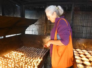Cary lighting the final butter lamps at the stupa
