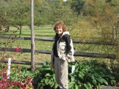 M.P. standing in the herb garden in Jockey Hollow.