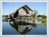 A typical house on stilts on the lakeshore