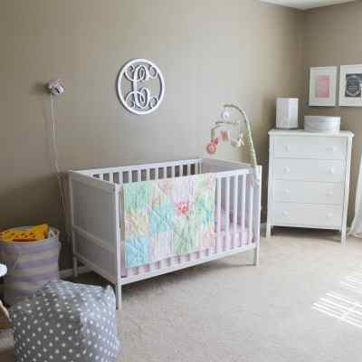 Neutral nursery with pops of color, ikea crib, budget friendly