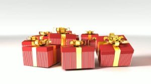 stock-footage-gifts-with-golden-ribbons-isolated-on-white